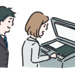 コピー機の使い方を教える